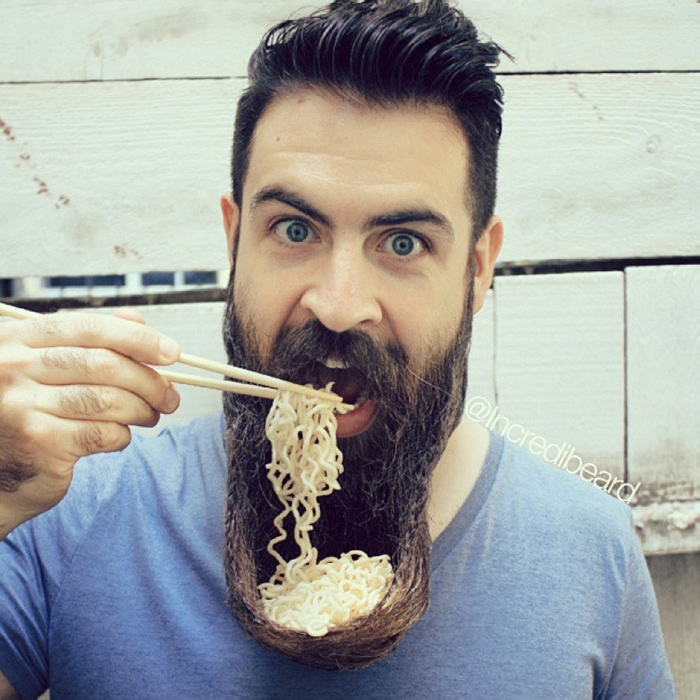 Man using his beard as a bowl for his food