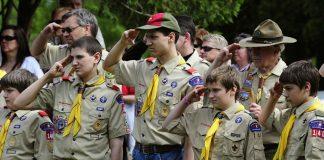 Boy scouts saluting