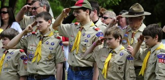 Boy scouts saluting