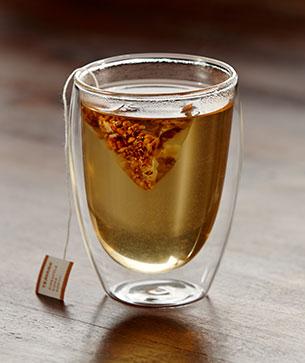 Warm glass of Pineapple Kona Pop tea