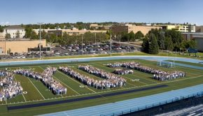 Photo of hundreds of BYU-Idaho students forming BYU-I for a tenth anniversary picture