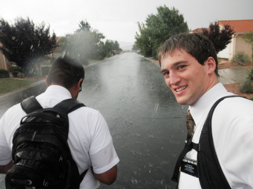 Two Lds missionaries getting wet in the rain
