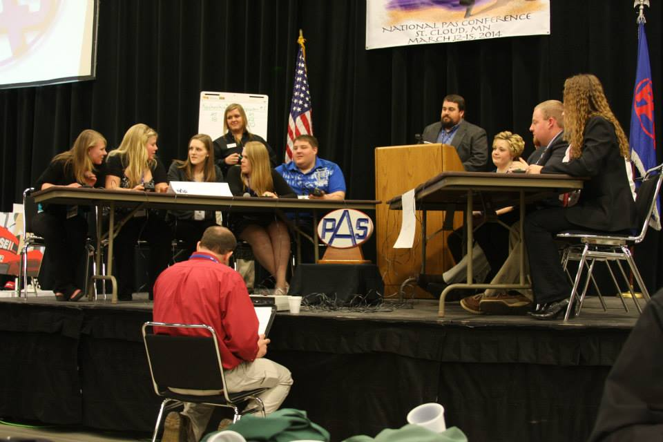 Two teams of students debating at an agricultural competition
