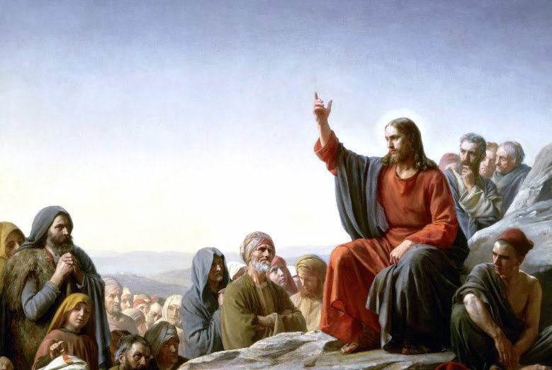 Jesus teaching a sermon to a group of people