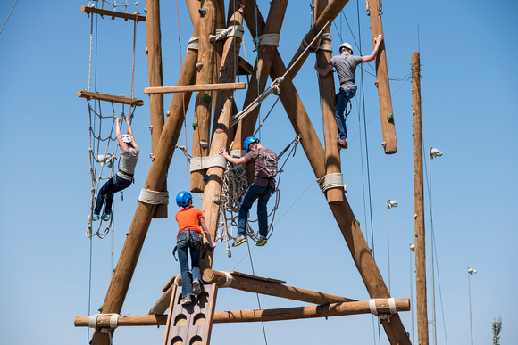 people climbing up the different challenges at the BYU-Idaho ropes course