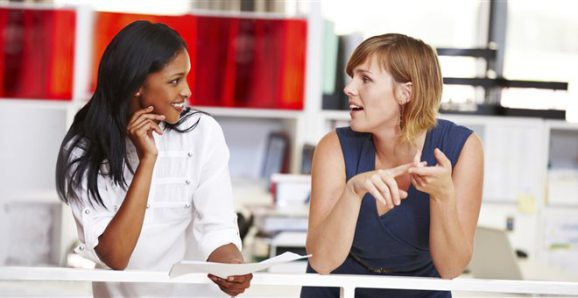 A woman telling her friend how she got called to speak - Image via Huffingtonpost.com