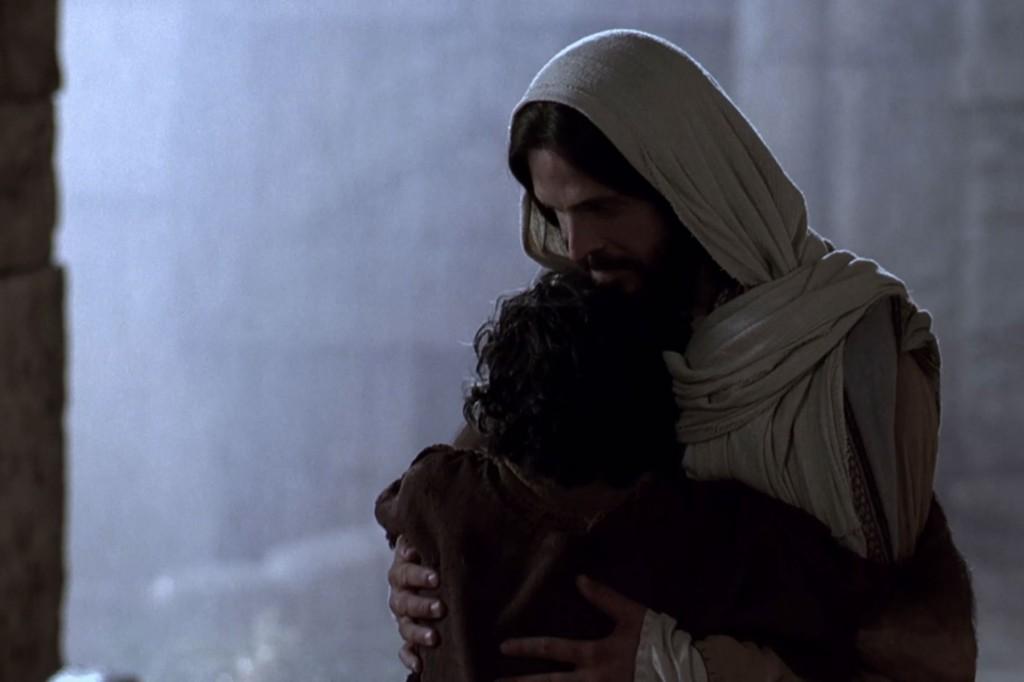 Jesus embracing a man