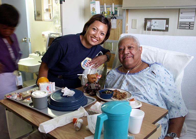 Jonnalynn Cummings visits with Air Force veteran Leon Gilbert at Chicago's Westside VA Hospital