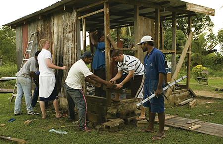 Volunteers donating time to help build a house