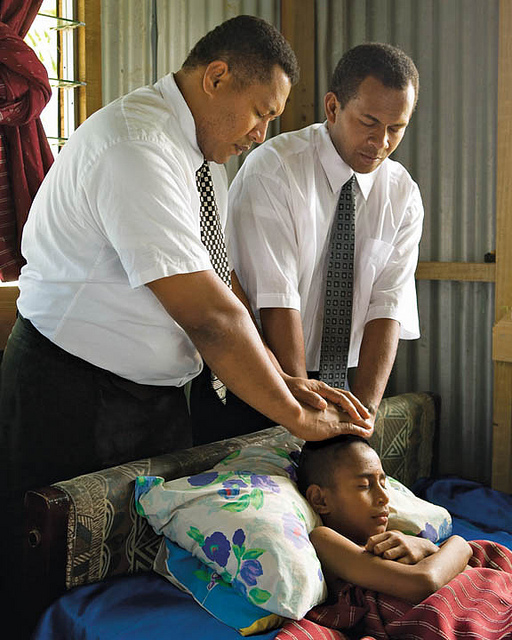 Mormon elders bless a sick child
