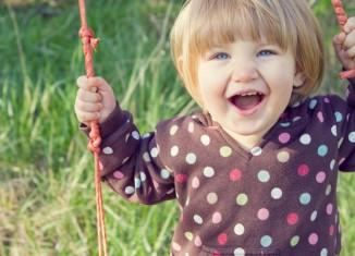 Happy Girl on Swing