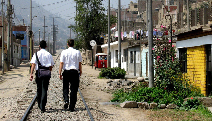 Two missionaries walking in a 3rd world street