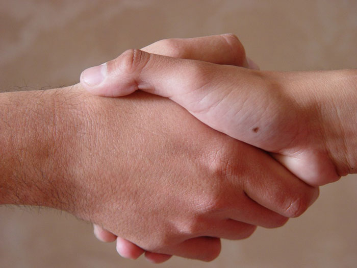 Parent shaking hands with a babysitter
