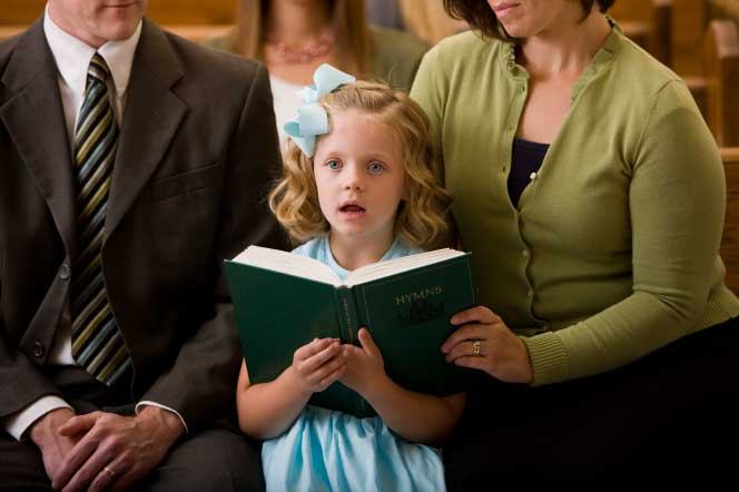 Little girl singing the hymns