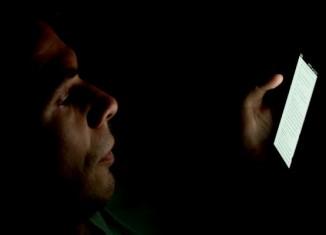 man reading tablet