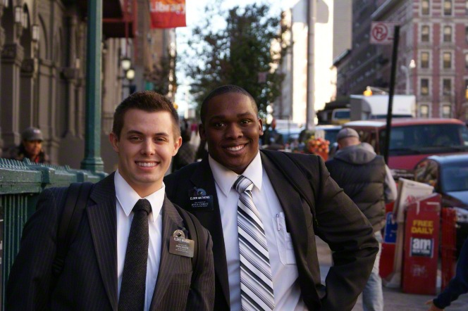 two LDS missionaries smile