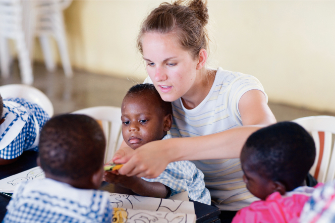 Woman works with children in Africa