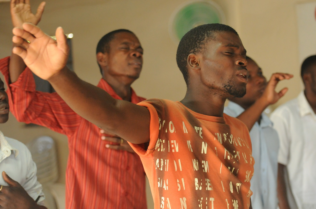 Men worshiping and praising