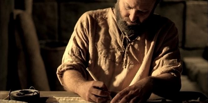 Paul writing scriptural text