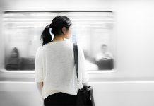 girl watching train pass