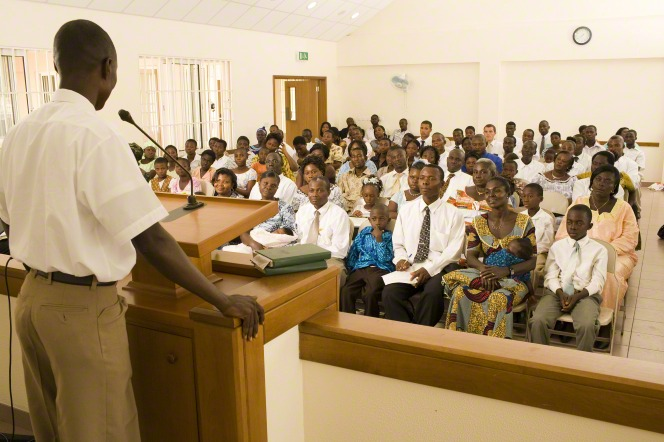 A returned missionary speaking to a ward congregation