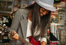 Latter-day Saint woman plays guitar