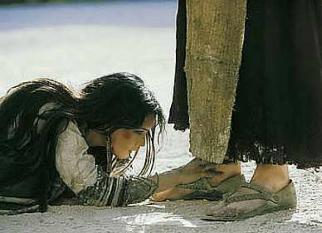 woman at the feet of Jesus