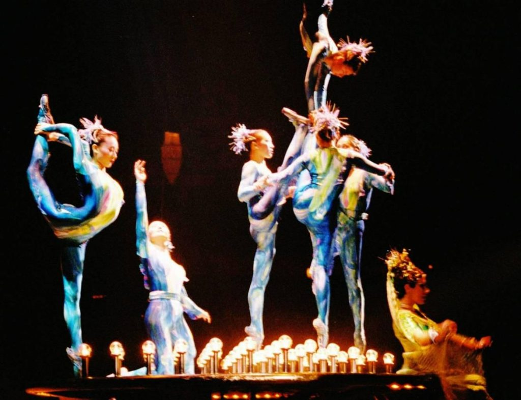 Cirque du Soleil gymnasts and contortionists performing.