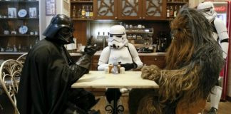 Darth Vader, Chewbaca, and a Storm Trooper at a table