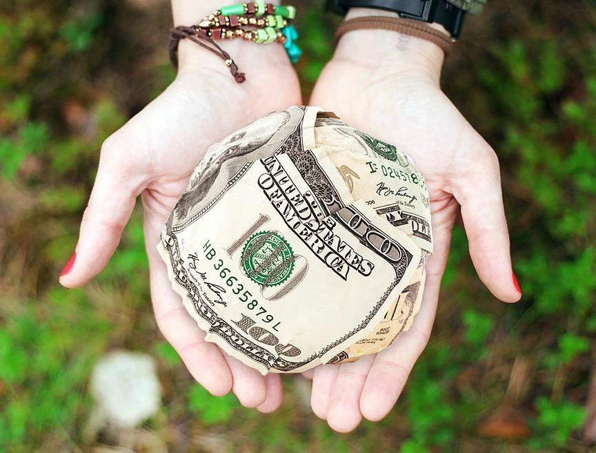 Money origami in hand