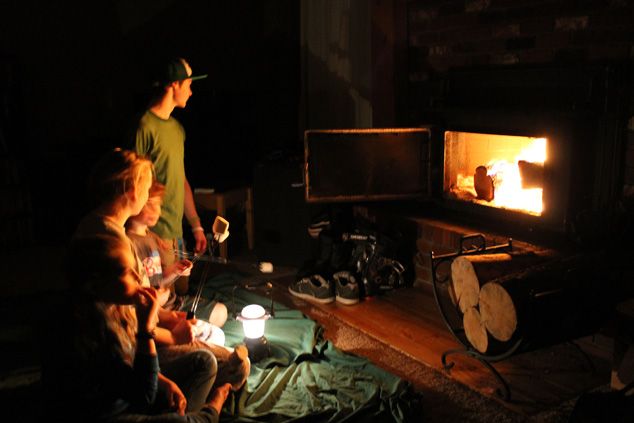 Family roasting marshmallows in power outage