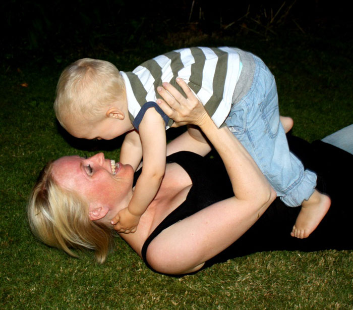 Mormon mother plays with child
