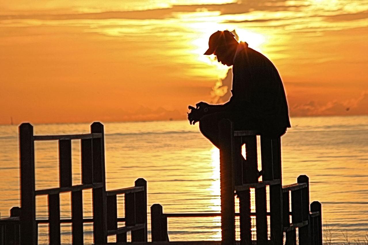 Man prays over what to do next