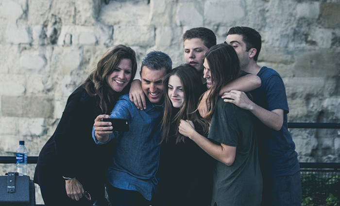 Family taking a selfie picture after the manner of the popular trend.