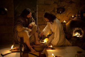 Jesus washing Peter's feet.