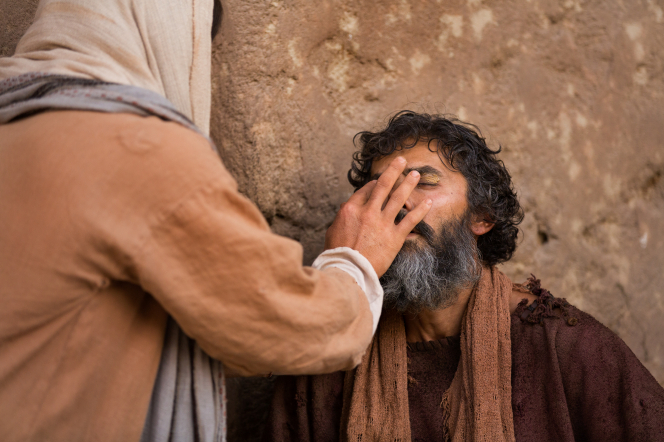 condescension of God through healing the blind man