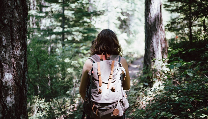 Girl on path in forest