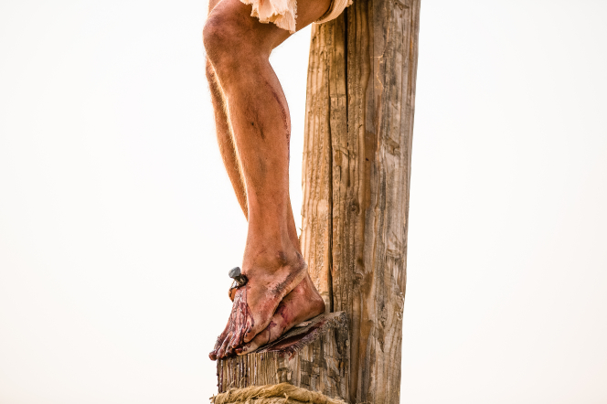 condescension of god through his death on the cross