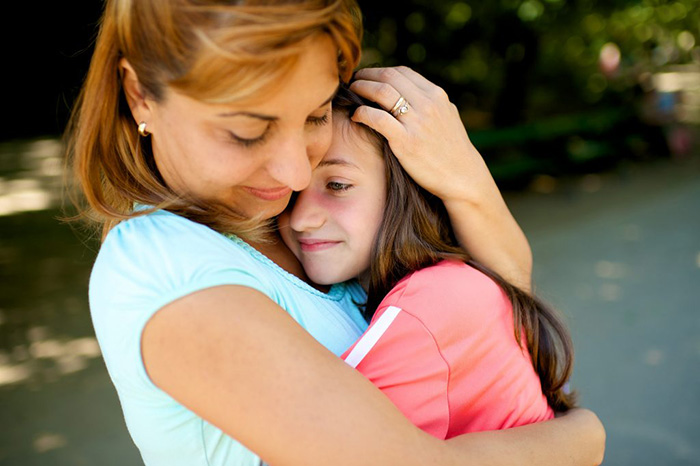 Daughter hugs mom for mothers day