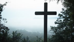 The cross of Jesus Christ with misty background