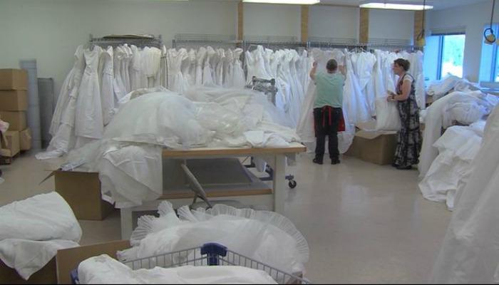 Women sort through DI wedding dress donation