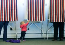 voting LDS Patriotic baby in voting booth
