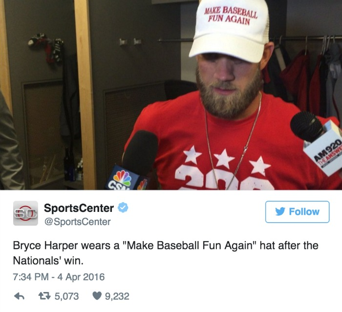 Bryce Harper wears a make baseball fun again hat after nationals win