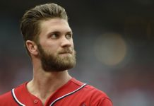 Bryce Harper in baseball uniform looking up