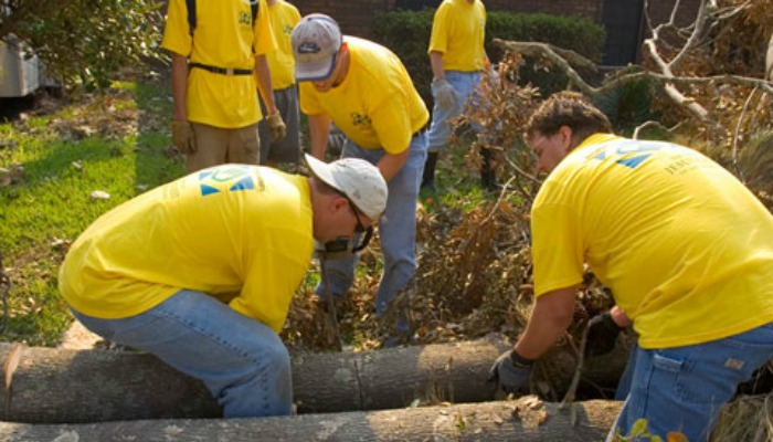 Mormon Helping Hands volunteers help clear downed tree after Katrina