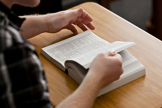 College student reading the scriptures
