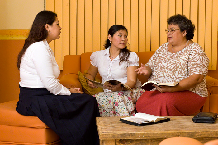 Visiting teachers reading scriptures