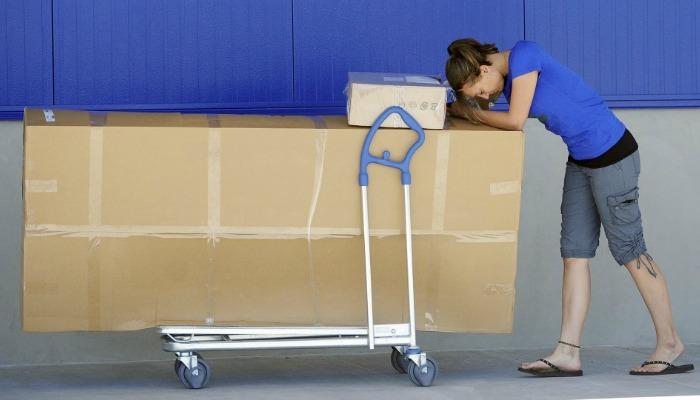 ikea nightmare woman pushing boxes