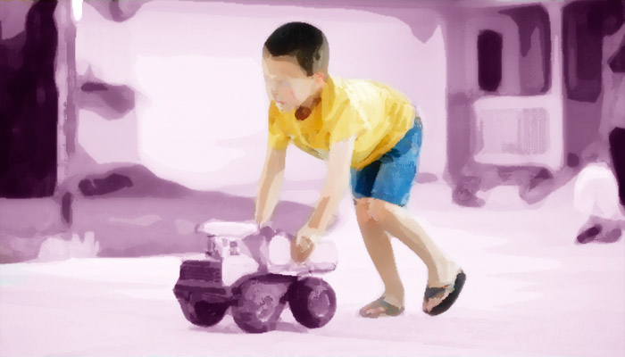 Child with toy truck graphic