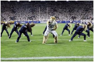 Cosmo dancing on football field